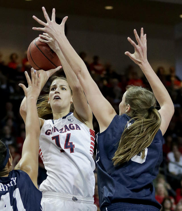 Gonzaga's Sunny Greinacher (14) shoots against BYU's Jennifer Hamson, right, and Morgan Bailey in the first half of an NCAA West Coast Conference women's tournament championship college basketball game, Tuesday, March 11, 2014, in Las Vegas. (AP Photo/Julie Jacobson)