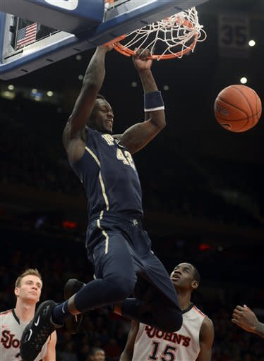 Pitt's Talib Zanna dunks in the first half of an NCAA college basketball game against St. John's at Madison Square Garden in New York, Sunday, Feb. 24, 2013. (AP Photo/Henny Ray Abrams)