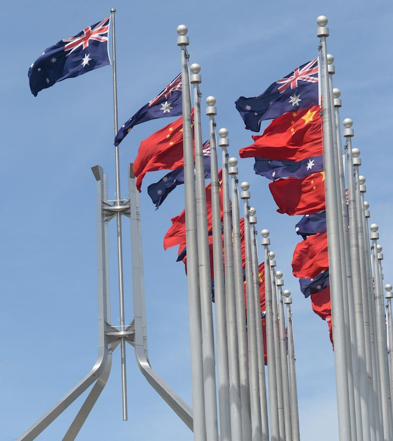 Chinese and Australian flags fly at Parliament House in Canberra. Source: AAP