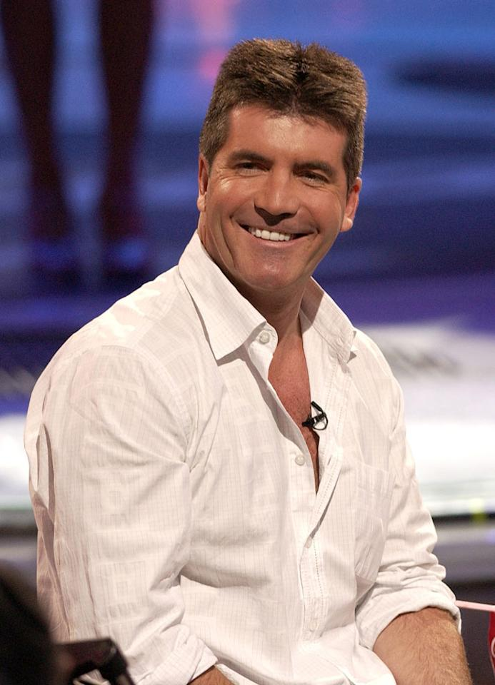 """A brilliant smile, a brilliantine shine…is Simon's <a href=""""http://www.forbes.com/lists/2006/53/P3QW.html"""" rel=""""nofollow"""">rank among 2006's top 100 celebrities</a> (thanks to four reality shows and launching the singing quartet Il Divo) loosening him up? He parts his hair down the center with the Biblical determination of parting the Red Sea, and changes up his wardrobe with a white button-front shirt. But he ends up baring more cleavage than Paula Abdul. All that's missing is a gold chain. E! devotes one of its """"True Hollywood Story"""" specials to Simon, but his Midas touch isn't working for other American reality productions: """"American Inventor"""" lasts just one season on ABC, and Taylor Hicks wins the fifth """"<a href=""""/american-idol/show/34934"""">Idol</a>"""" season and will go on to become one of the lowest earning """"Idols"""" in the show's history."""