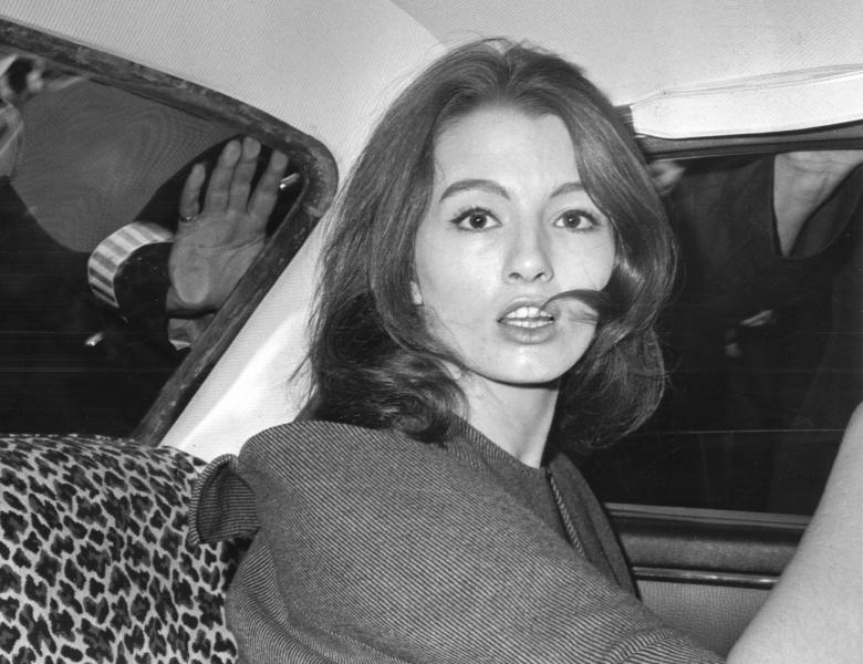 FILE - In this July 22, 1963 file photo, Christine Keeler is photographed during a vice charges case against osteopath Dr. Stephen Ward. The model had been having an affair with Cabinet member John Profumo at the same time as having a liaison with a Russian naval attache. The scandal rocked the political establishment. It was one of the great postwar crises in Britain, the latest of which relates to the country's struggles to leave the European Union. (AP Photo/File)