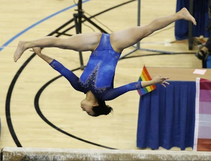 WESTWOOD, CA - MARCH 12: Samantha Sakti competes on the balance bea during UCLA gymnastics team's final home meet of the season against San Jose State at UCLA Pauley Pavilion on Friday, March 12, 2021. (Myung J. Chun / Los Angeles Times)