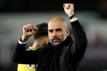 Soccer Football - Premier League - Swansea City vs Manchester City - Liberty Stadium, Swansea, Britain - December 13, 2017 Manchester City manager Pep Guardiola celebrates at the end of the match Action Images via Reuters/Andrew Boyers