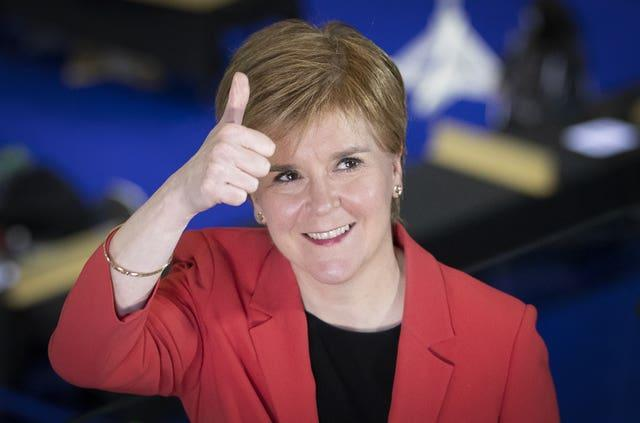 Sturgeon giving a thumbs up