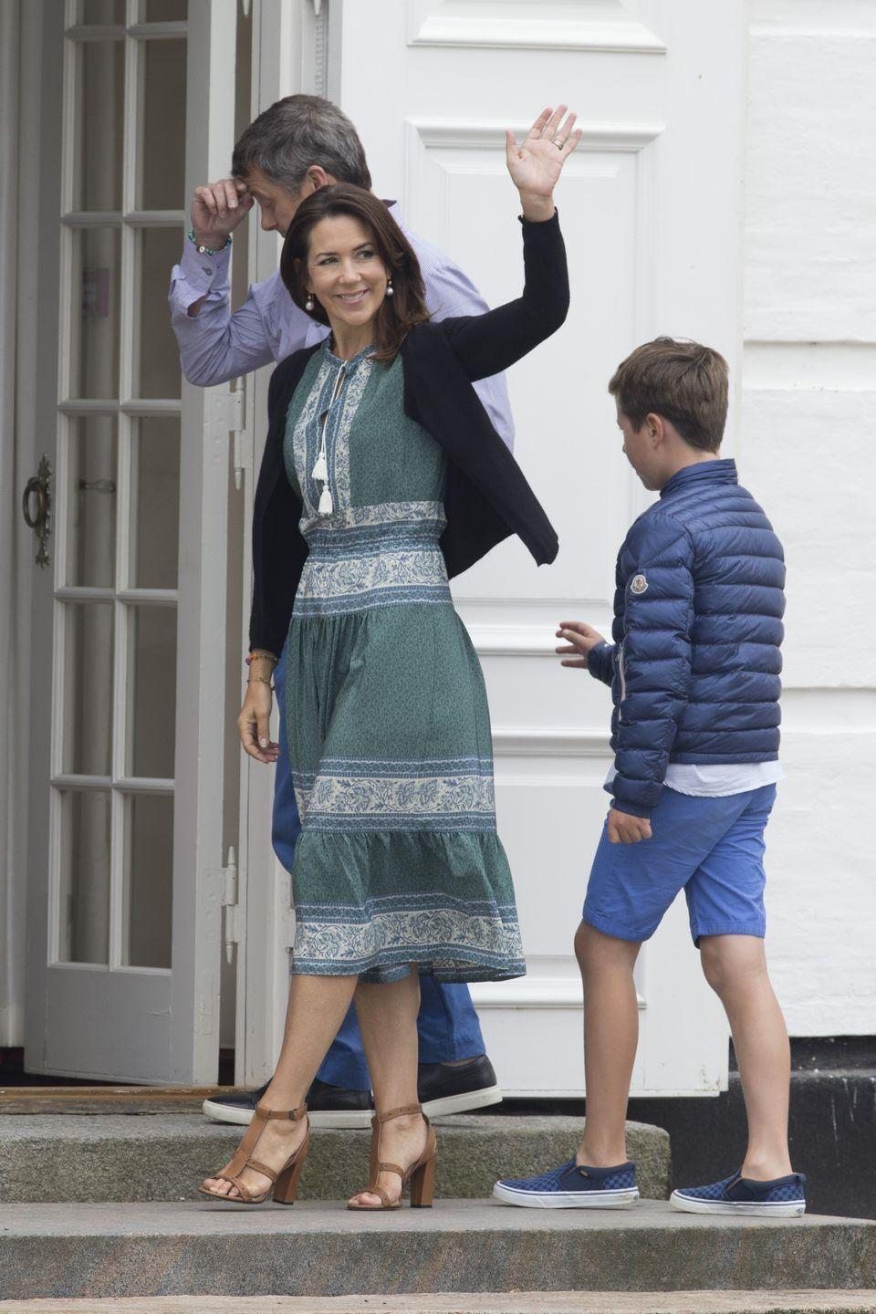 """<p>Princess Mary<span class=""""redactor-invisible-space""""> is</span> pictured here in a bohemian Sea NY dress, sweater and heels for her family's annual summer photo.</p>"""
