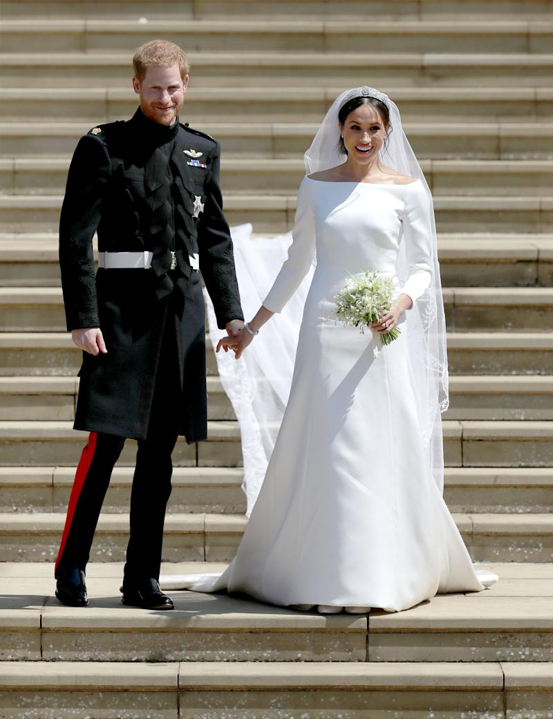 "Markle&rsquo;s <a href=""https://www.huffingtonpost.ca/entry/meghan-markle-wedding-dress_ca_5cd54c12e4b07bc72976b4ba"" target=""_blank"" rel=""noopener noreferrer"">ceremony dress</a> was designed by Clare Waight Keller for Givenchy."