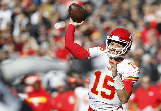 Kansas City Chiefs quarterback Patrick Mahomes (15) passes against the Oakland Raiders during the first half of an NFL football game in Oakland, Calif., Sunday, Dec. 2, 2018. (AP Photo/D. Ross Cameron)