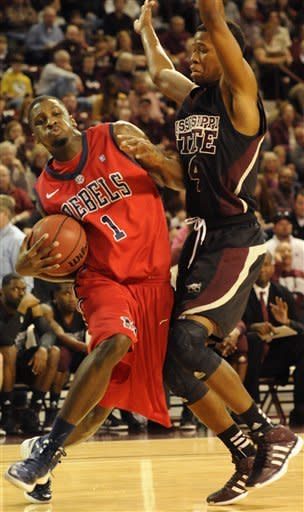 Mississippi's Terrance Henry (1) drives against Mississippi State's Rodney Hood (4) during the first half of their NCAA college basketball game in Starkville, Miss., Thursday, Feb. 9, 2012. (AP Photo/Jim Lytle)