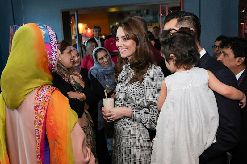 Britain's Catherine, Duchess of Cambridge reacts as she meets representatives from the UK Womens Muslim Council and women whose lives have benefitted from the Councils Curry Circle in Bradford on January 15, 2020. (Photo by Chris Jackson / POOL / AFP) (Photo by CHRIS JACKSON/POOL/AFP via Getty Images)
