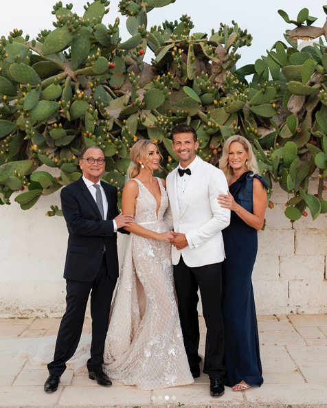<p>The couple — who have been together for five years — are huge on family, with Anna's sister's both appearing in the bridal party. Here is Tim and Anna with her parents. Cute! Source: Instagram/AnnaHeinrich </p>