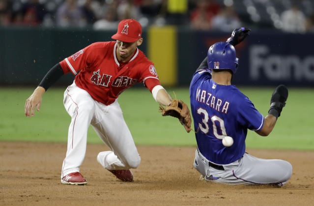 Texas Rangers' Nomar Mazara steals second as Los Angeles Angels shortstop Andrelton Simmons misses the throw during the second inning of a baseball game in Anaheim, Calif., Wednesday, Sept. 12, 2018. (AP Photo/Chris Carlson)