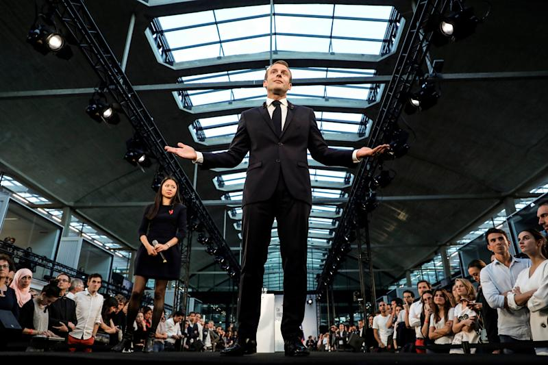 French President Emmanuel Macron addresses the audience as he visits the Station F startup campus in Paris, France, Tuesday, Oct. 9, 2018. (Ludovic Marin/Pool Photo via AP)