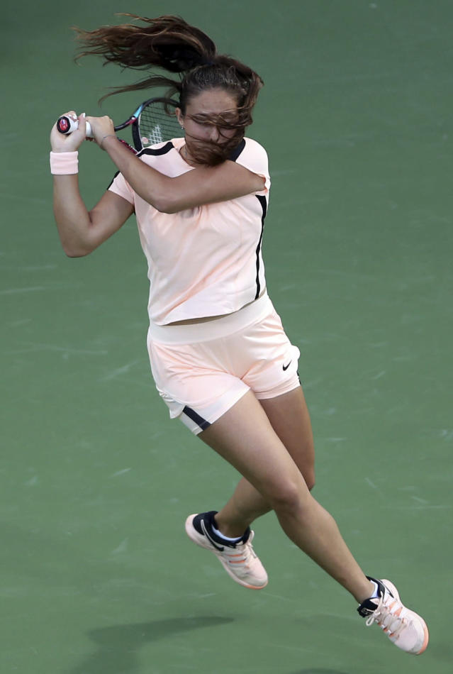 Daria Kasatkina of Russia returns the ball to Garbine Muguruza of Spain during a semi final match of the Dubai Duty Free Tennis Championship in Dubai, United Arab Emirates, Friday, Feb. 23, 2018. (AP Photo/Kamran Jebreili)