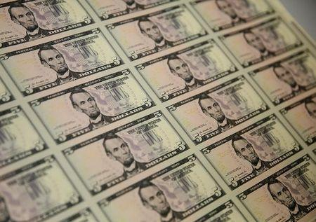 Dollar remains moderately higher vs. other majors