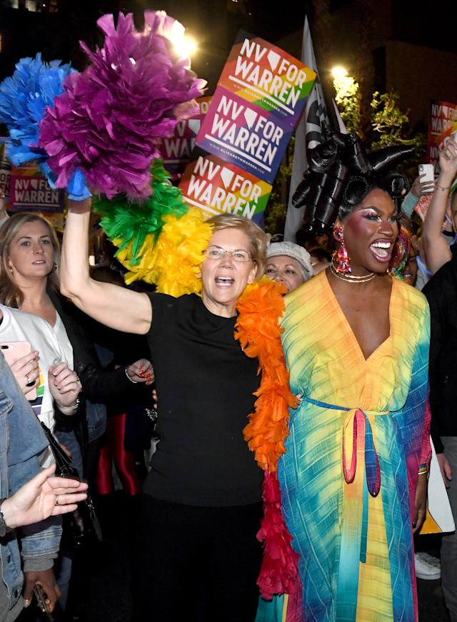 Sen. Elizabeth Warren and drag queen Shea Coulee march in the Southern Nevada Association of Pride Inc. 22nd annual PRIDE Night Parade in Las Vegas, Nevada. (Photo by Ethan Miller/Getty Images)