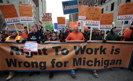 Union members and supporters march to the Michigan State Capitol building to protest against right-to-work legislation in Lansing, Michigan in this December 11, 2012, file photo. REUTERS/Rebecca Cook/Files