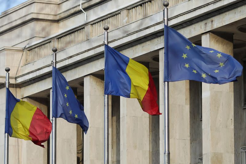 Romanian and EU flags are pictured in front of the headquarters of the Romanian Government