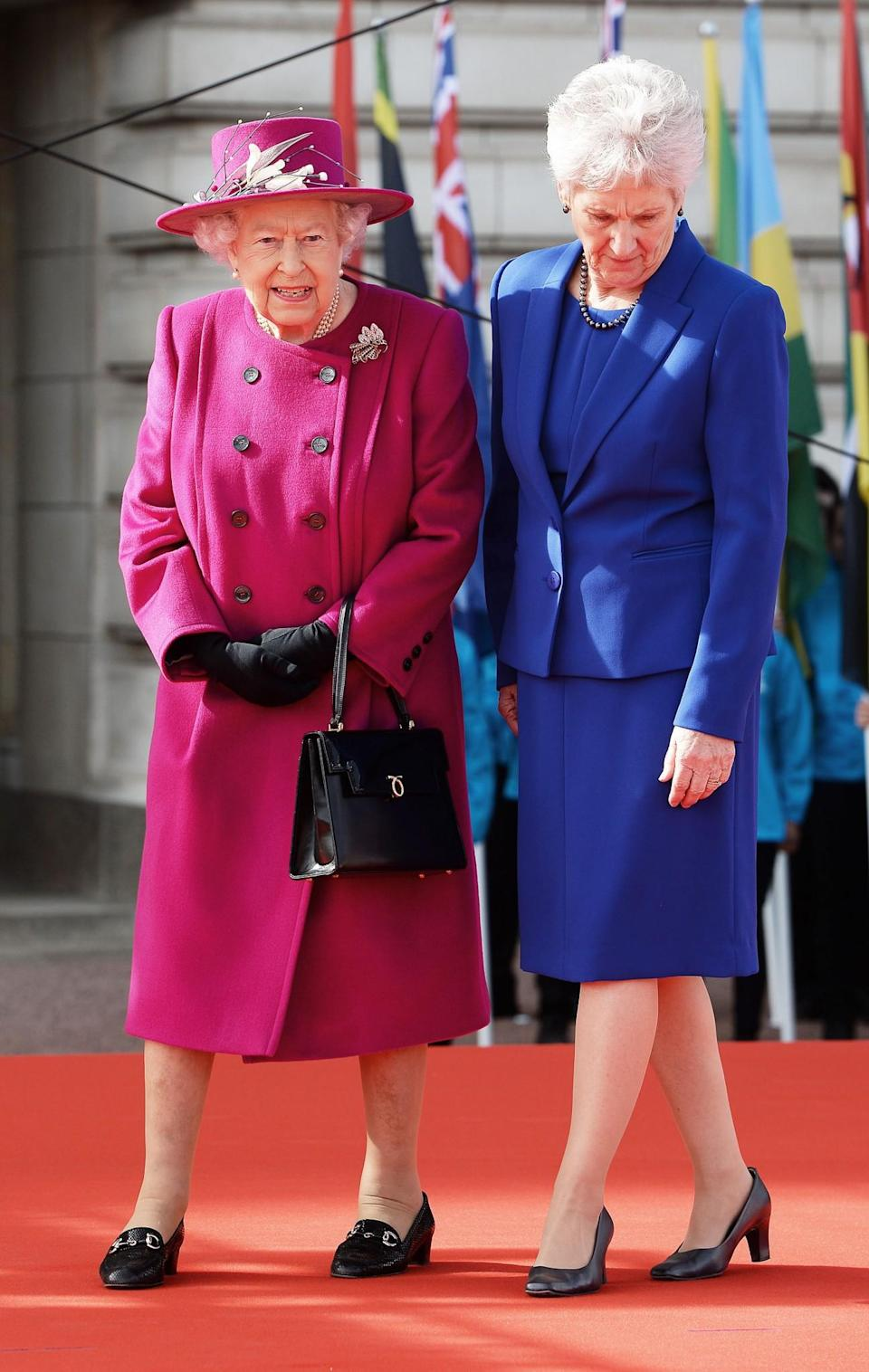 <p>A hot pink look was seen at the 2017 Commonwealth Day.<br><i>[Photo: PA]</i> </p>