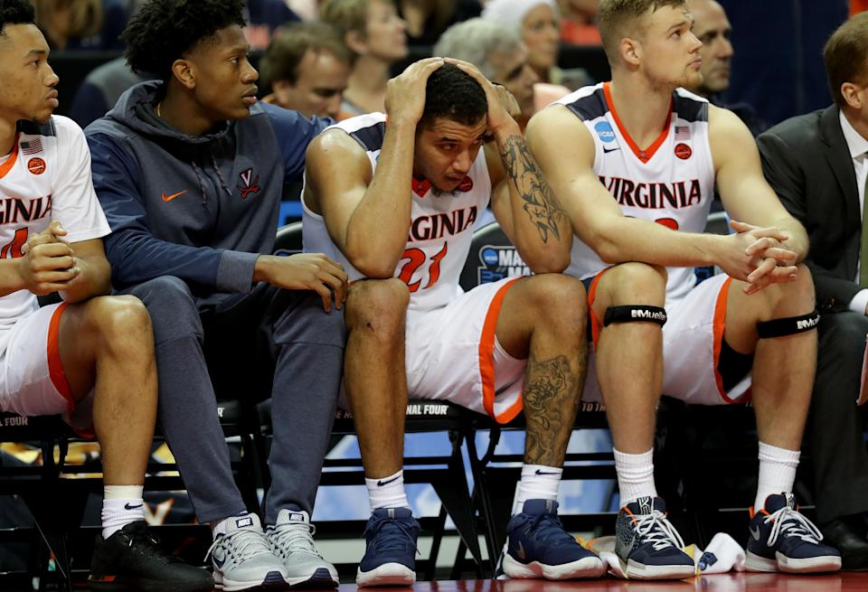 <p>Isaiah Wilkins #21 of the Virginia Cavaliers reacts to their 74-54 loss to the UMBC Retrievers during the first round of the 2018 NCAA Men's Basketball Tournament at Spectrum Center on March 16, 2018 in Charlotte, North Carolina. (Photo by Streeter Lecka/Getty Images) </p>