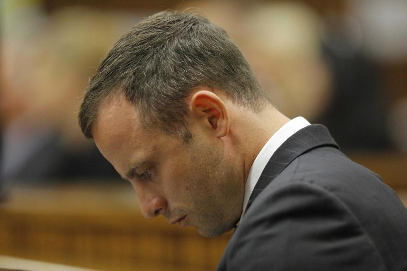 Oscar Pistorius sits in the dock on the second day of his trial at the high court in Pretoria, South Africa, Tuesday, March 4, 2014. Pistorius is charged with murder for the shooting death of his girlfriend, Reeva Steenkamp, on Valentines Day in 2013. (AP Photo/Kim Ludbrook, Pool)
