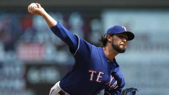 FILE - In this June 23, 2018, file photo, Texas Rangers' pitcher Tony Barnette throws against the Minnesota Twins during a baseball game in Minneapolis. The Chicago Cubs have added bullpen help, agreeing to a $750,000, one-year contract with Barnette, a deal containing an option, escalator and bonus opportunities that could raise its value to $4.5 million over two seasons. (AP Photo/Jim Mone, File)