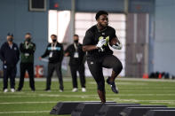 North Carolina running back Javonte Williams participates in the school's Pro Day football workout for NFL scouts in Chapel Hill, N.C., Monday, March 29, 2021. (AP Photo/Gerry Broome)