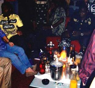 Nevin Shapiro said this photo was taken in his VIP section at Miami Beach's Dolce Ultra Lounge in October 2008. Along the left margin, Randy Phillips is seated in a yellow shirt. Shapiro, whose attire can be identified in other pictures from that night, is seated next to Phillips in blue.