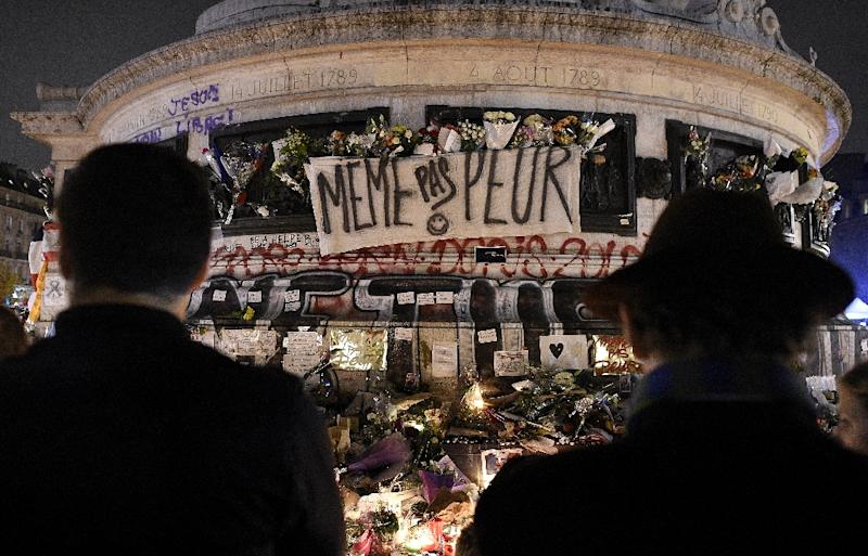 People gather at a makeshift memorial at the Place de la Republique in Paris on November 15, 2015, two days after a series of deadly jihadist attacks killed 129 in the French capital (AFP Photo/Franck Fife)