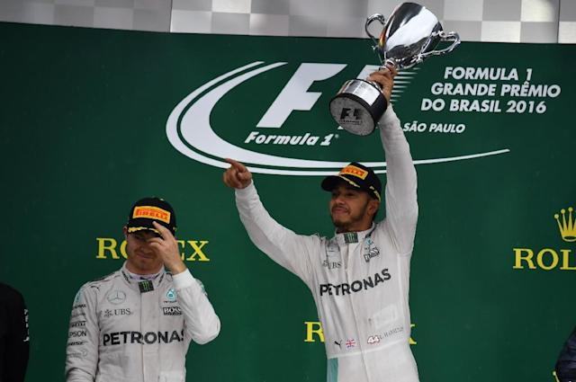 The Lewis Hamilton (R) and Nico Rosberg (L) soap opera has played out over a record 21 episodes from Australia to the tense climax in Abu Dhabi (AFP Photo/Nelson Almeida)