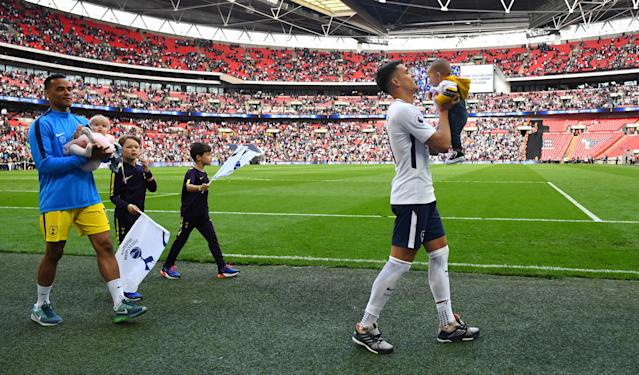 "Soccer Football - Premier League - Tottenham Hotspur vs Leicester City - Wembley Stadium, London, Britain - May 13, 2018 Tottenham's Erik Lamela and Michel Vorm with children after the match REUTERS/Dylan Martinez EDITORIAL USE ONLY. No use with unauthorized audio, video, data, fixture lists, club/league logos or ""live"" services. Online in-match use limited to 75 images, no video emulation. No use in betting, games or single club/league/player publications. Please contact your account representative for further details."