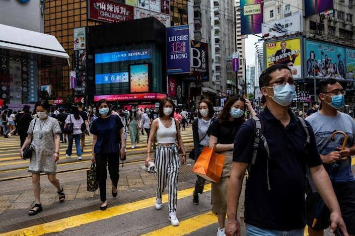 Analysts and members of the business community have said the law could add to the risk and complexity of doing business in Hong Kong, but it is unlikely to spark a mass exodus of foreign firms (AFP Photo/ISAAC LAWRENCE)