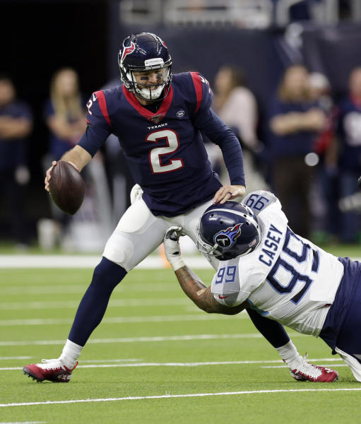Houston Texans quarterback AJ McCarron (2) is sacked by Tennessee Titans defensive end Jurrell Casey (99) during the first half of an NFL football game Sunday, Dec. 29, 2019, in Houston. (AP Photo/Michael Wyke)