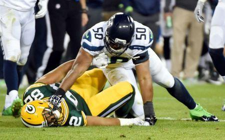 Seattle Seahawks linebacker K.J. Wright (50) hits Green Bay Packers tight end Richard Rodgers (82) after a play in the fourth quarter at Lambeau Field. Wright was ejected from the game. Sep 20, 2015; Green Bay, WI, USA. Benny Sieu-USA TODAY Sports