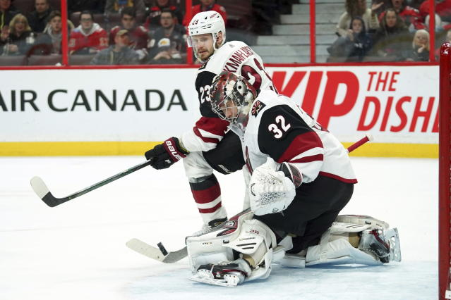 Arizona Coyotes goaltender Antti Raanta (32) and defenseman Oliver Ekman-Larsson (23 watch the puck during second-period NHL hockey game action in Ottawa, Ontario, Thursday, Feb. 13, 2020. (Chris Wattie/The Canadian Press via AP)