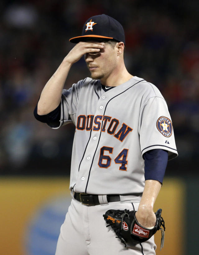 Houston Astros starting pitcher Lucas Harrell runs his hand across his face as he works against the Texas Rangers in the third inning of a baseball game Monday, Aug. 19, 2013, in Arlington, Texas. Harrell was pulled in the same inning. (AP Photo/Tony Gutierrez)
