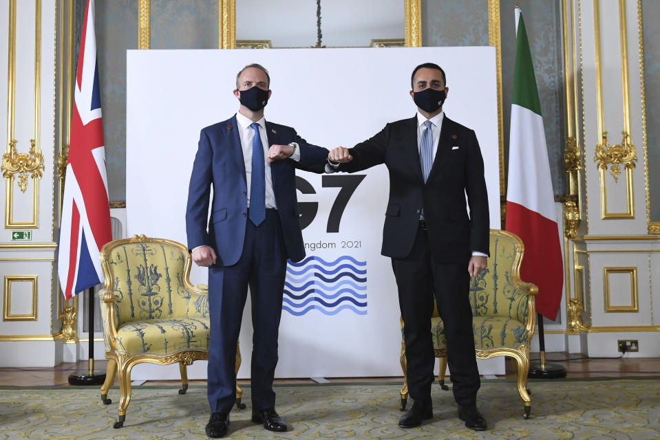 Britain's Foreign Secretary Dominic Raab, left, poses for a photo alongside Italian Minister of Foreign Affairs Luigi Di Maio, ahead of bi-lateral talks, during the G7 foreign ministers' meeting, in London, Tuesday May 4, 2021. Foreign ministers from the Group of Seven wealthy industrialized nations gathered in London to grapple with threats to health, prosperity and democracy. It is their first face-to-face meeting in more than two years. (Stefan Rousseau/Pool via AP)
