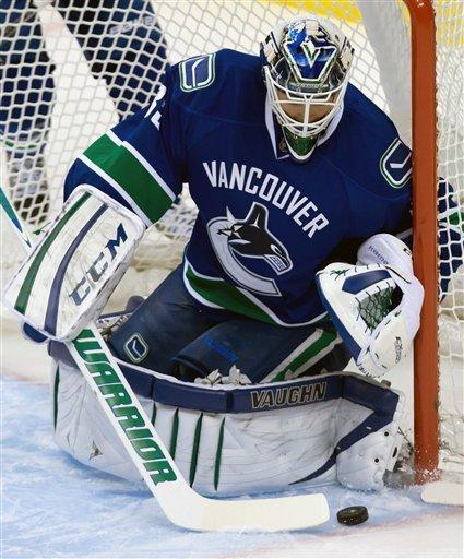 Vancouver Canucks' goalie Cory Schneider stops an Anaheim Ducks shot during the first period of an NHL hockey game in Vancouver, British Columbia on Saturday, Jan. 19, 2013. (AP Photo/The Canadian Press, Darryl Dyck)