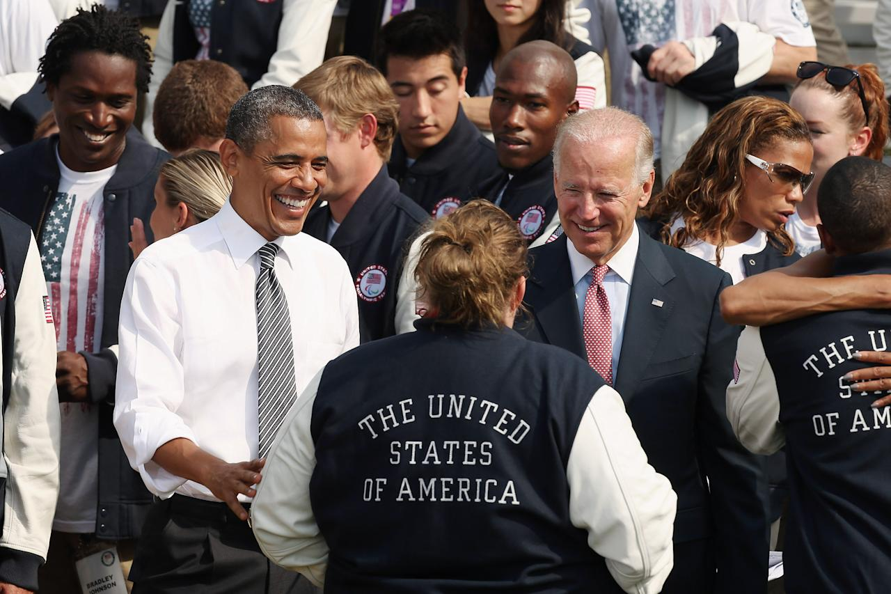 WASHINGTON, DC - SEPTEMBER 14:  U.S. President Barack Obama (L) and Vice President Joe Biden welcome Olympic weightlifter Holley Mangold (C) during an event with members of the U.S. Olympic and Paralympic teams at the White House September 14, 2012 in Washington, DC. The U.S. team brought home 104 medals, 46 of them gold medals, from the games in London.  (Photo by Chip Somodevilla/Getty Images)