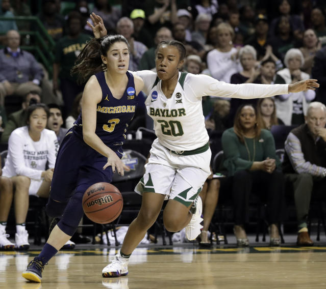 Michigan guard Katelynn Flaherty (3) drives to the basket past Baylor guard Juicy Landrum (20) in the first half of a second-round game at the NCAA women's college basketball tournament in Waco, Texas, Sunday, March 18, 2018. (AP Photo/Tony Gutierrez)