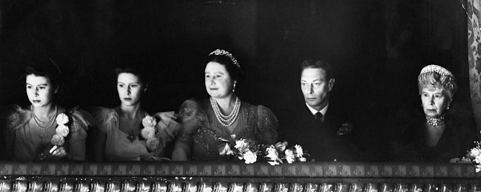 <p>A rare photo of then-Princess Elizabeth attending the ballet with her sister, parents, and grandmother. This was taken at the reopening of the Royal Opera House at the end of World War II.</p>