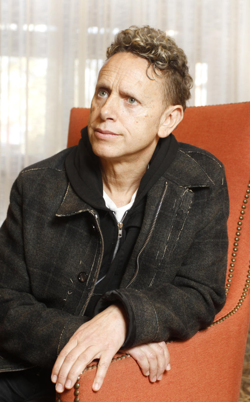 """In this March 13, 2013 photo, Martin Gore, of Depeche Mode, poses for a photograph during the SXSW Music Festival, in Austin, Texas. Depeche Mode's dark, electronic grooves are all over """"Delta Machine,"""" the trio's 13th release, out this week. (Photo by Jack Plunkett/Invision/AP)"""