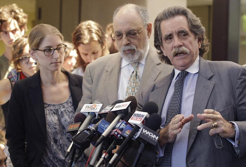 Defense attorney Thomas Durkin, right, speaks to the media accompanied by defense attorneys Sarah Gelsomino, left, and Michael Deutsch after their clients, who were arrested on terrorism charges before last month's NATO summit, appeared in court, Tuesday, June 12, 2012, in Chicago. The three defendants allegedly plotted to hurl Molotov cocktails at President Barack Obama's campaign headquarters. (AP Photo/M. Spencer Green)