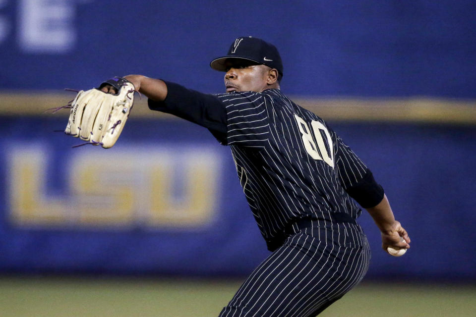 Vanderbilt pitcher Kumar Rocker throws to an Arkansas batter during the first inning of an NCAA college baseball game during the Southeastern Conference tournament Thursday, May 27, 2021, in Hoover, Ala. (AP Photo/Butch Dill)