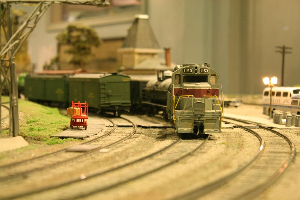 A model train speeds around a corner. After 67 years in the Liberty Village location, The Model Railroad Club of Toronto will be moving to make way for a condo.