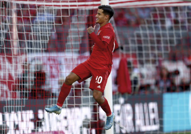 Bayern's Philippe Coutinho celebrates after scoring his side's 3rd goal by penalty during the German Bundesliga soccer match between FC Bayern Munich and 1. FC Cologne in Munich, Germany, Saturday, Sept. 21, 2019. (AP Photo/Matthias Schrader)