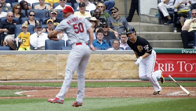 Pittsburgh Pirates starting pitcher Jeff Locke hits a pitch past St. Louis Cardinals starting pitcher Adam Wainwright in the fourth inning of the baseball game on Wednesday, Aug. 27, 2014, in Pittsburgh. The groundball was played by second baseman Daniel Descalso and relayed to force out Ike Davis at second for the final out of the inning. (AP Photo/Keith Srakocic)