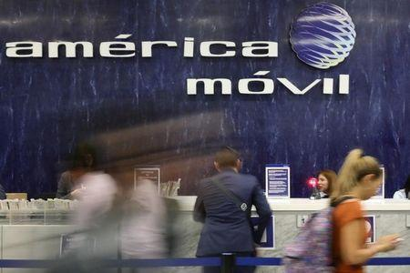 The logo of America Movil is pictured on the wall of a reception area in the company's corporate offices in Mexico City, Mexico, May 18, 2017. REUTERS/Edgard Garrido