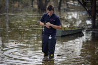 Koby Bellanger, an animal control officer, rescues a kitten from a house surrounded by floodwater in the aftermath of Hurricane Ida, Sunday, Sept. 5, 2021, in Lafitte, La. (AP Photo/John Locher)