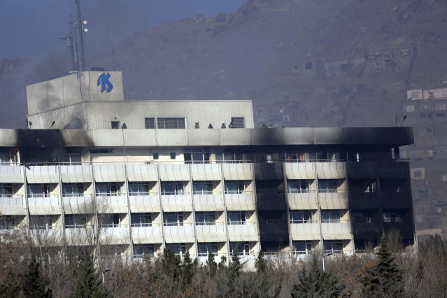 <p>Afghan security personnel are seen at the roof of Intercontinental Hotel after an attack in Kabul, Afghanistan, Sunday, Jan. 21, 2018. Gunmen stormed the hotel and sett off a 12-hour gun battle with security forces that continued into Sunday morning, as frantic guests tried to escape from fourth and fifth-floor windows. (Photo: Rahmat Gul/AP) </p>