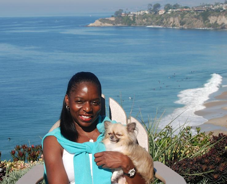 "This Oct. 28, 2011, photo provided by The Jet Set Pets shows Kelly E. Carter, founder of The Jet Set Pets, posing with her longhair Chihuahua, Lucy, at the Ritz-Carlton, Laguna Niguel in Dana Point, Calif. Travel for humans during holidays is tough enough: Long lines, crowds everywhere, extra bags full of presents. Throw a pet in the mix, and it's a recipe for disaster. ""Some dogs don't like to travel, some love it,"" she said. ""You have to know your pet."" (AP Photo/The Jet Set Pets, Regina DiMartino)"
